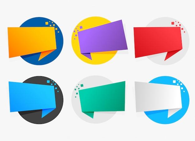 Simboli di origami colorati con lo spazio del testo