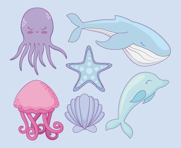 Simpatica balena con animali marini di gruppo