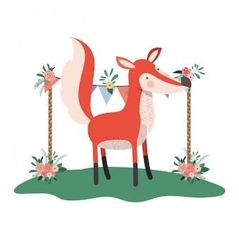 Simpatica e adorabile volpe con cornice floreale