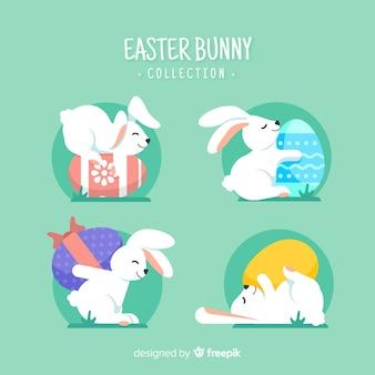 Simpatici coniglietti pasquali con raccolta di uova