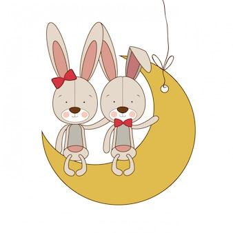Simpatici coniglietti seduti sulla luna