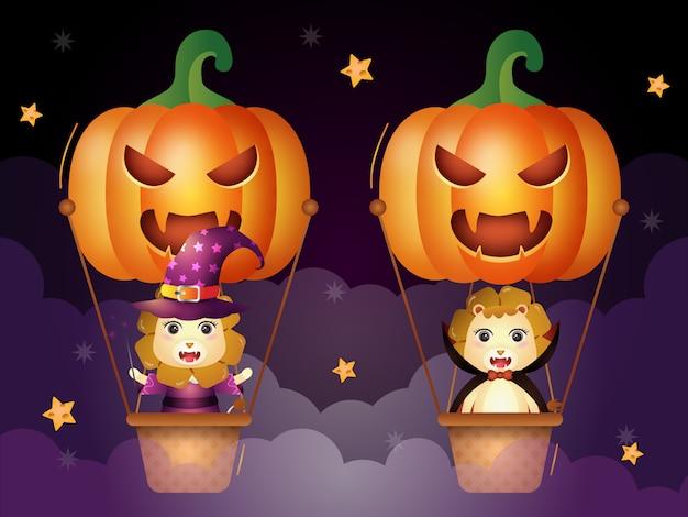 Simpatici leoni con costume di halloween in mongolfiera di zucca