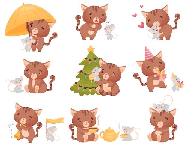 Simpatico cartone animato gatto e topo decorano l'albero di natale