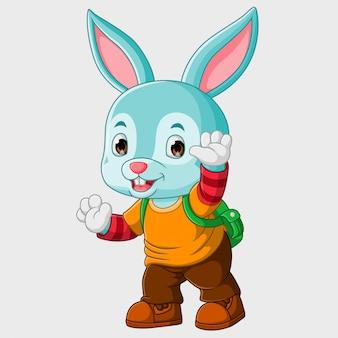 Simpatico coniglietto che saluta, sta per andare a scuola,