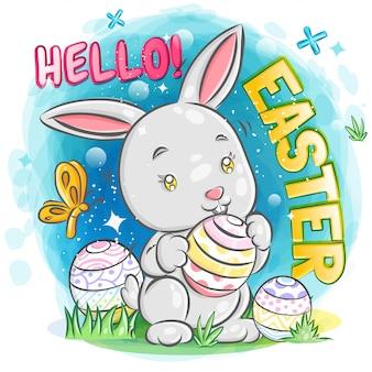 Simpatico coniglietto con uovo di pasqua