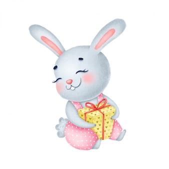 Simpatico coniglietto di compleanno dei cartoni animati con un regalo