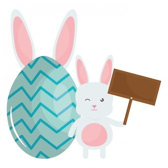 Simpatico coniglio con carattere di etichetta in legno