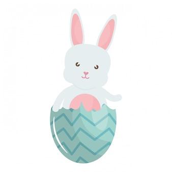 Simpatico coniglio con uovo di pasqua rotto dipinto