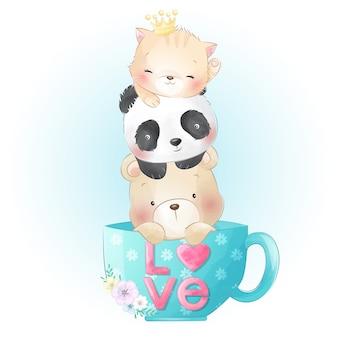 Simpatico gattino, panda e orso seduto all'interno della tazza di caffè