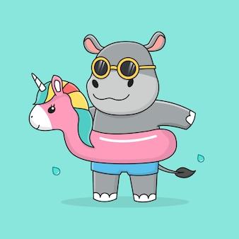 Simpatico ippopotamo con anello di nuotata unicorno e occhiali da sole