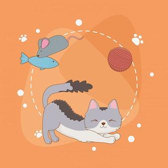 Simpatico mascotte piccolo gatto con rotolo di lana e pesce