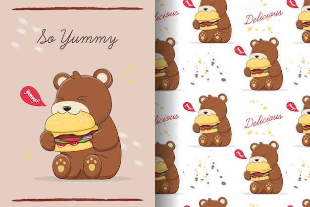 Simpatico orso che mangia hamburger senza cuciture e carta