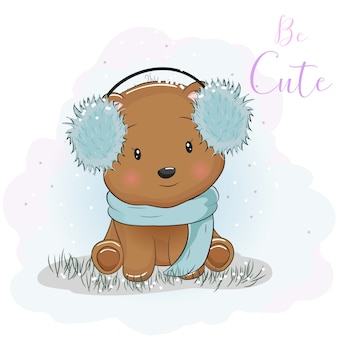 Simpatico orso dei cartoni animati con cuffie e sciarpa di pelliccia