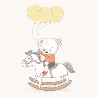 Simpatico orso guidare un cavallo a dondolo con palloncini