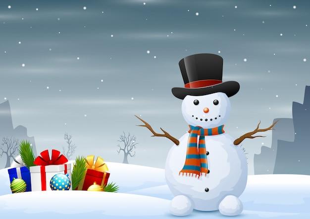 Simpatico pupazzo di neve con scatole regalo sul paesaggio invernale