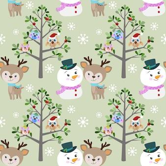 Simpatico pupazzo di neve e cervi con gufo in inverno.