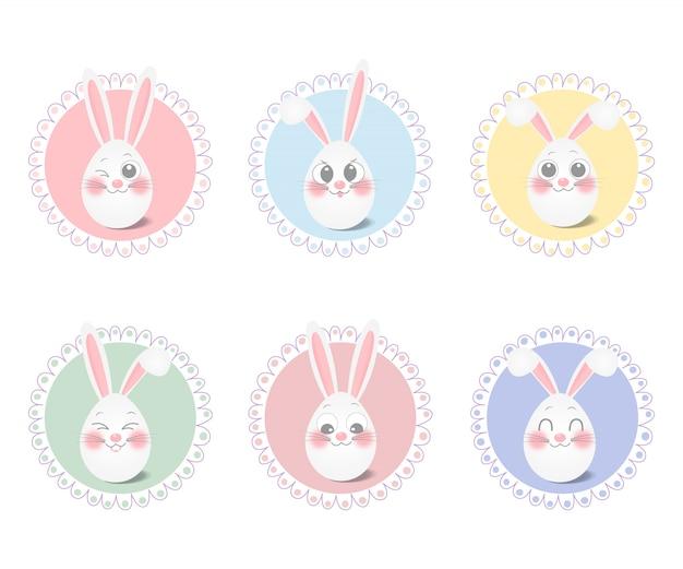 Simpatico uovo di pasqua con orecchie di coniglio in colori pastello