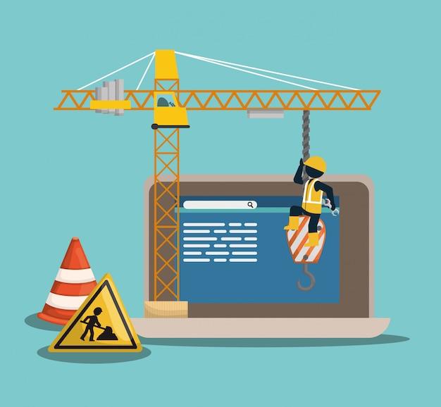 Sito in costruzione con laptop