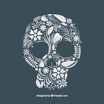 Skull background fatto di disegnata a mano elementi floreali