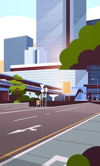 Skyline della strada di città con moderni grattacieli e metropolitana
