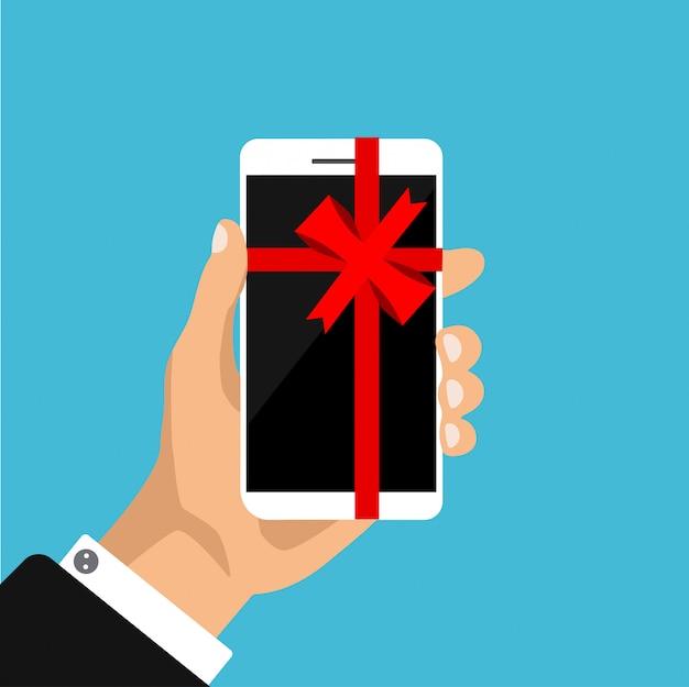Smartphone bianco piatto con fiocco rosso e nastro. telefona come un regalo, presente. illustrazione. isolato.