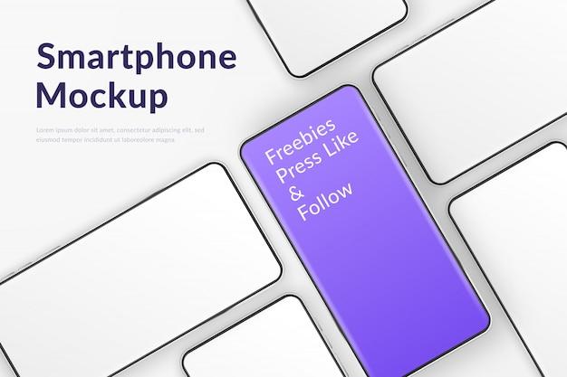 Smartphone realistici. telefoni cellulari con schermo bianco vuoto e uno viola. modello moderno dei telefoni cellulari su fondo bianco. illustrazione dello schermo del dispositivo