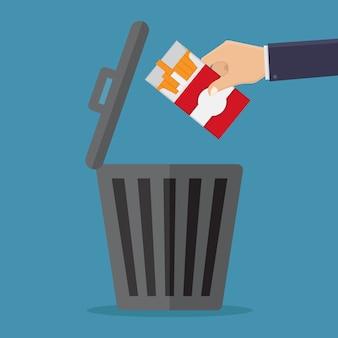 Smetti di fumare, getta sigarette nella spazzatura