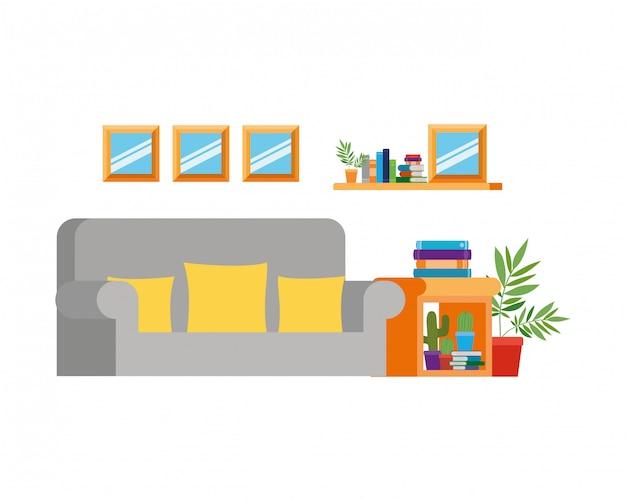 Soggiorno con divano e pila di libri