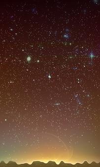 Sol levante dietro montagne e cielo stellato