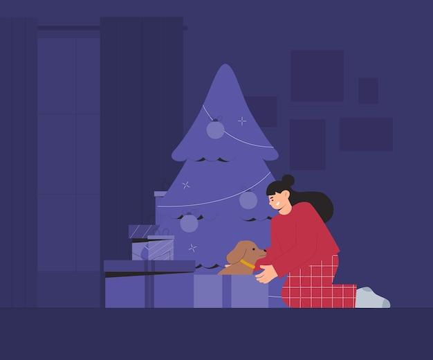 Sorpresa di natale, regalo in scatola - cane da compagnia per bambino. il bambino apre un regalo di natale vicino all'albero in una stanza accogliente.