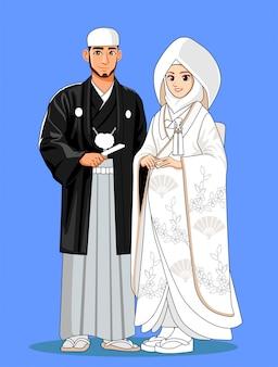 Spose giapponesi musulmane con abiti tradizionali bianchi.