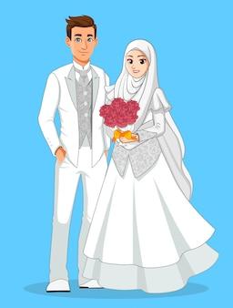 Spose musulmane nazionali in abiti bianchi e argento.