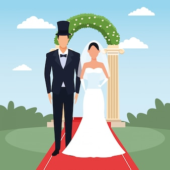 Sposo e sposa che controllano arco e paesaggio floreali