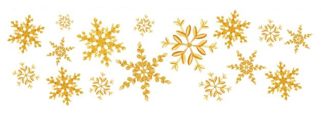 Spruzzata di fiocchi di neve d'oro di natale di un fiocchi di neve scatter casuali