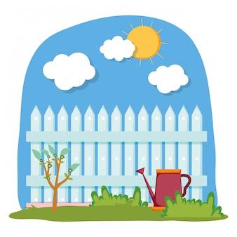 Spruzzatore del giardino con recinzione nella scena del campo