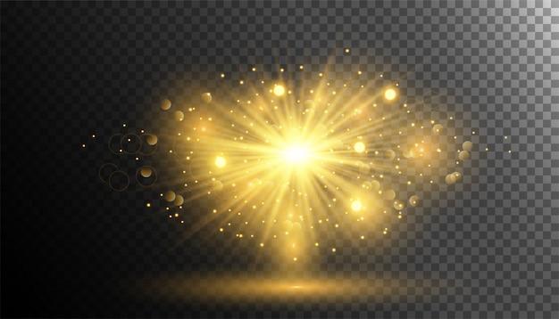 Spruzzi di polvere di glitter oro con scoppi di luce splendente