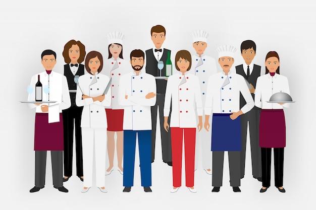 Squadra del ristorante dell'hotel in uniforme. gruppo di personaggi della ristorazione in piedi insieme chef, cuoco, camerieri e barman.