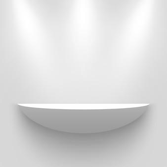 Stand espositivo bianco, illuminato da faretti. mensola.