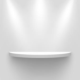 Stand espositivo bianco, illuminato da faretti. piedistallo tondo con ombra. mensola.