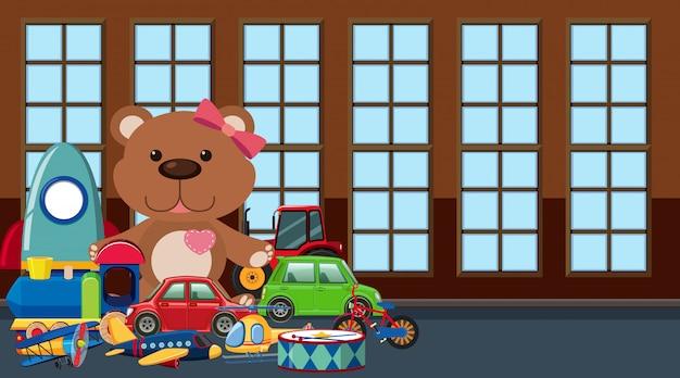 Stanza con molti giocattoli sul pavimento