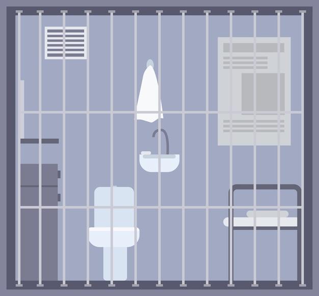 Stanza vuota della prigione, della prigione o del centro di detenzione con letto, wc e lavandino e altre strutture dietro le sbarre o la griglia