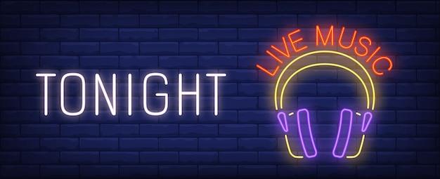 Stasera insegna al neon di musica dal vivo. cuffie luminose di dj sul muro di mattoni.