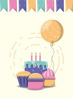 Stendardi decorativi e torta e cupcakes di compleanno sopra fondo bianco