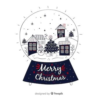 Stile disegnato a mano di progettazione della palla di neve di natale