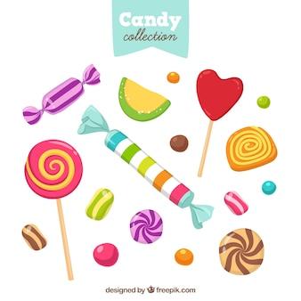 Stile disegnato colorato collezione di caramelle in mano