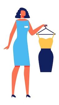 Stilista della donna con il vestito su priorità bassa bianca