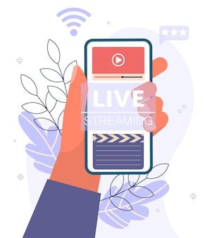 Streaming live, concetto di trasmissione. video podcast blogging telefono in mano.