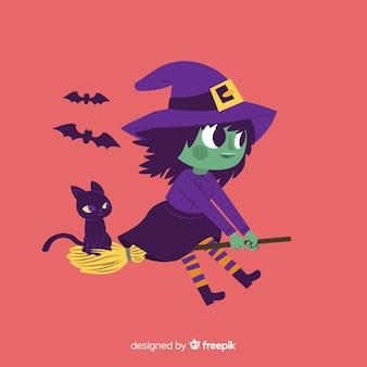 Strega di halloween carino con gatto