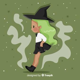 Strega di halloween carino con i capelli verdi