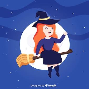 Strega di halloween carino con una scopa